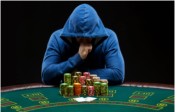 What is 'slowplaying' in poker, and how does it work?